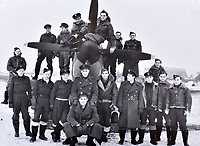 BNPS.co.uk (01202 558833)<br />Pic: C&T/BNPS<br /><br />Squadron relax with a Spitfire in winter snow in Belgium.<br /> <br /> A fascinating photo album has sold for £1200 at auction - the previously unseen photographs chart the wartime career of Polish aristocrat Antoni Lipkowski -revealing how the emigree from Nazi Europe became a fighter pilot in the RAF.<br /> <br /> Flight Lieutenant Antoni Lipkowski escaped Poland when Germany invaded in 1939 and was desperate to join in the fight against the Nazis.<br /> <br /> Previously a cavalry officer, he retrained as a pilot and joined one of the Polish squadrons based in Britain which did such sterling work defending these skies in World War Two.<br /> <br /> Flt Lt Lipkowski, of 316 Polish Fighter Squadron, was very tall for a pilot and turned heads with his 'handsome' appearance.<br /> <br /> There are images of him in the cockpit of his Spitfire and posing nonchalantly in front of it with a cigarette in his hand.