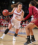 SIOUX FALLS, SD - MARCH 5:  Tia Hemiller #4 of South Dakota drives against Denver defender. (Photo by Dick Carlson/Inertia)