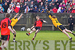 John Kelliher(15) of Tarbert scores the final point to level the match against Listowel Emmets in the North Kerry Senior Football Final held last Sunday in Bob Stack Park, Ballybunion.