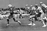 Oakland Raider Mark Van Eeghen runs away from San Diego Chargers. (1978 photo/Ron Riesterer)
