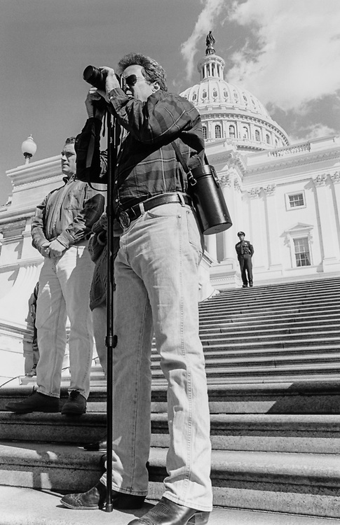 Rep. Bill Orton, D-Utah, looking like a photo pro as he photographs the Million Man March on Oct. 16, 1995. (Photo by Maureen Keating/CQ Roll Call)