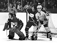 Seals vs Vancouver, Seals Tony Featherstone along the net Canucks goalie Dunc Wilson, along with Barry Wilkins.  (1971 photo by Ron Riesterer)