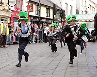 17-03-2014: Killarney Legion GAA Club juvenile members create a  comical scene to show Killarney Town Council  being abolished and chased out of town by 'Enda Kenny' and 'Phil Hogan'  at  the St. Patrick's Day Parade in KIllarney, Co. Kerry on Monday. Picture: Eamonn Keogh (MacMonagle, Killarney)