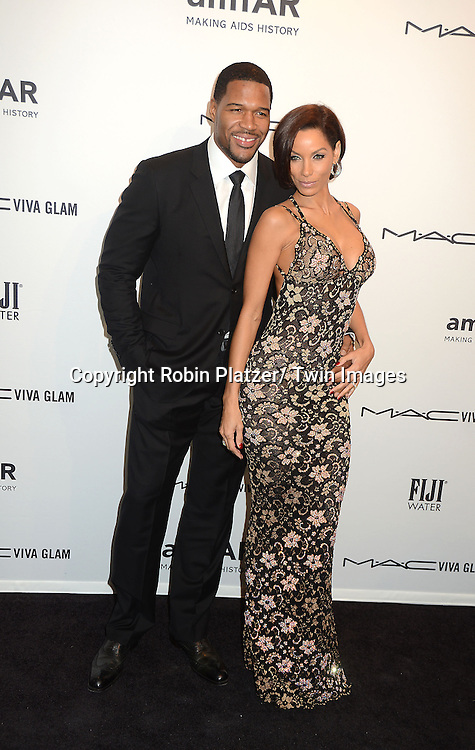 Michael Strahan and Nicole Murphy attends the amfAR New York Gala to kick off Fashion Week on February 6, 2013 at Cipriani Wall Streetin New York City. The honorees were Heidi Klum, Janet Jackson  and Kenneth Cole.