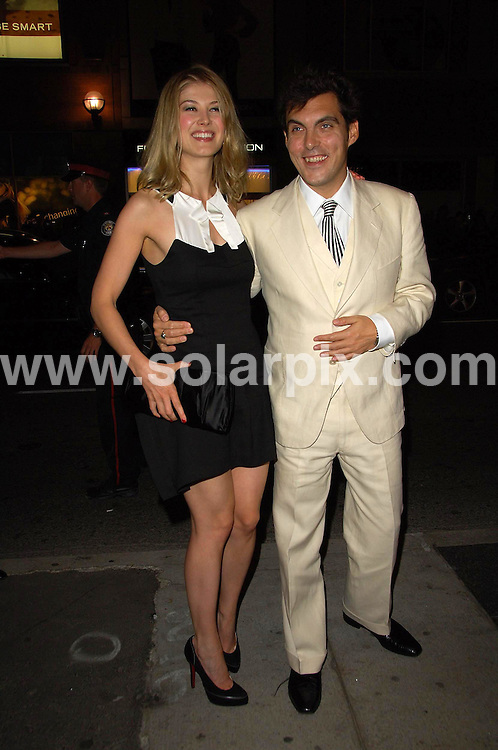 **ALL ROUND PICTURES FROM SOLARPIX.COM**.**WORLDWIDE SYNDICATION RIGHTS**.Guests, Keira Knightley,Rosemund Pike, Ken Loach, Joe Wright and James McAvoy, arriving at the premiere for the film  ATONEMENT in Toronto, Canada. 10th Sept 2007..This pic: Rosemund Pike and Joe Wright..JOB REF: 4678 MSR    DATE: 10_09_2007.**MUST CREDIT SOLARPIX.COM OR DOUBLE FEE WILL BE CHARGED* *UNDER NO CIRCUMSTANCES IS THIS IMAGE TO BE REPRODUCED FOR ANY ONLINE EDITION WITHOUT PRIOR PERMISSION*