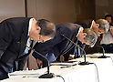 July 21, 2015, Tokyo, Japan - Toshiba President Hisao Tanaka, center, accompanied by two top executives, takes a deep bow at the start of a news conference at its headquarters in Tokyo on Tuesday, July 21, 2015.  Tanaka announced his resignation, taking responsibility for his part in manipulating deceptive accounting during the news conference. The Japanese electronics and electrical equipment group's manipulated profits add up to 1.25 billion dollars from fiscal 2008 through December 2014. They are, from left: Chairman Masashi Muromachi, who succeeds Tanaka; President Tanaka; and Executive Director Keizo Maeda, who steps down from his post. (Photo by Natsuki Sakai/AFLO) AYF -mis-