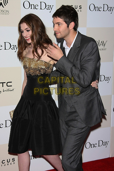 "Anne Hathaway & Jim Sturgess.The New York Premiere of ""One Day"" held at AMC Loews Lincoln Square Cinemas, New York, NY, USA..August 8th, 2011.half length black dress gold strapless beads beaded  grey gray suit waistcoat clutch bag hand side profile 3/4.CAP/LNC/TOM.©LNC/Capital Pictures."