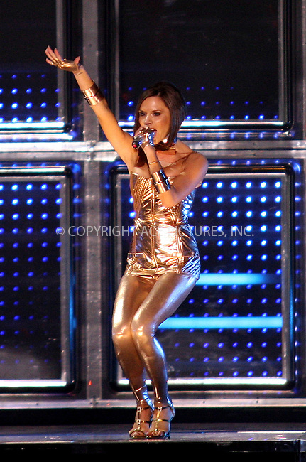 Victoria Beckham of the Spice Girls performing live at the Koln Arena in Cologne, Germany - 20 December 2007..FAMOUS PICTURES AND FEATURES AGENCY 13 HARWOOD ROAD LONDON SW6 4QP UNITED KINGDOM tel +44 (0) 20 7731 9333 fax +44 (0) 20 7731 9330 e-mail info@famous.uk.com .FAM22202