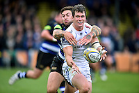 Ian Whitten of Exeter Chiefs offloads the ball after being tackled by Matt Banahan of Bath Rugby. Aviva Premiership match, between Bath Rugby and Exeter Chiefs on October 17, 2015 at the Recreation Ground in Bath, England. Photo by: Patrick Khachfe / Onside Images