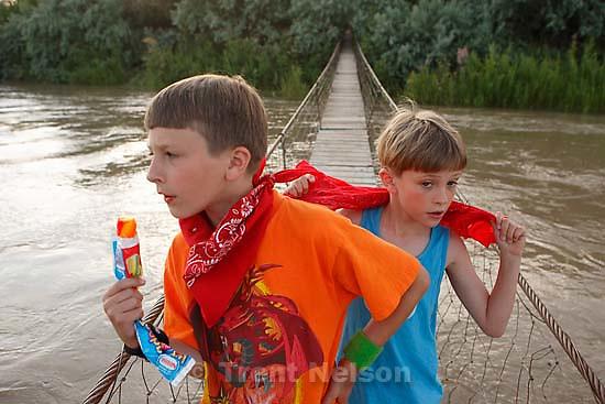 Noah Nelson and Nathaniel Nelson on Navajo swing bridge<br />