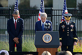 United States President Barack Obama, Secretary of Defense Chuck Hagel, and Chairman of of the Joint Chiefs of Staff General Martin Dempsey pause during a moment of silence during a remembrance at the 12th anniversary commemoration of the 9/11 terrorist attacks at the Pentagon Memorial at the Pentagon in Washington, DC on September 11, 2013. Nearly 3,000 people were killed in the attacks in New York, Washington and Shanksville, Pennsylvania. <br /> Credit: Pat Benic / Pool via CNP