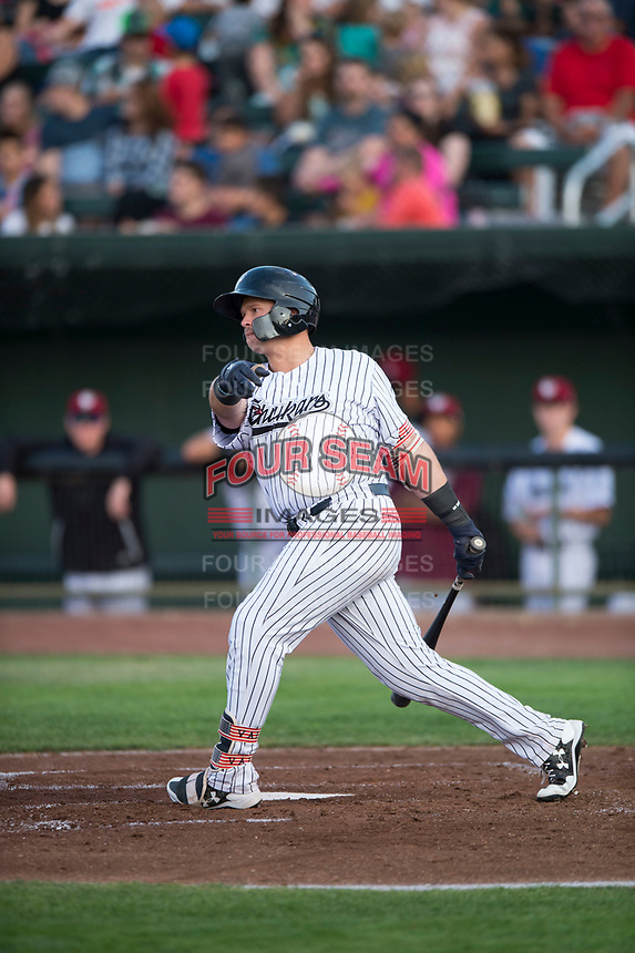 Idaho Falls Chukars designated hitter Chase Vallot (44) follows through on his swing during a Pioneer League game against the Great Falls Voyagers at Melaleuca Field on August 18, 2018 in Idaho Falls, Idaho. The Idaho Falls Chukars defeated the Great Falls Voyagers by a score of 6-5. (Zachary Lucy/Four Seam Images)