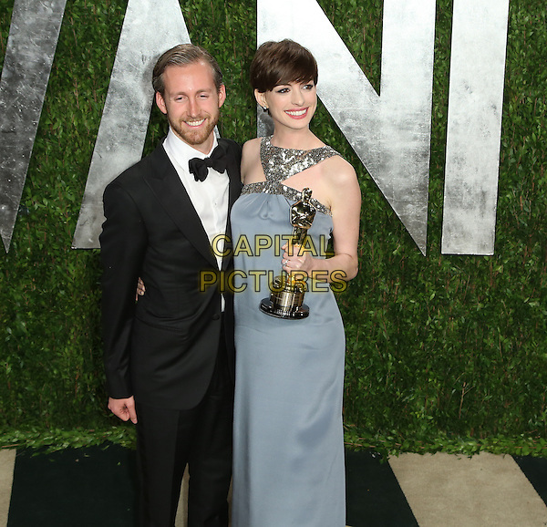 Adam Shulman & Anne Hathaway.2013 Vanity Fair Oscar Party following the 85th Academy Awards held at the Sunset Tower Hotel, West Hollywood, California, USA..February 24th, 2013.oscars half length silver gold sleeveless sequins sequined dress award trophy winner 3/4 tuxedo black white shirt beard facial hair blue grey gray.CAP/ADM/SLP/DOW.©Dowling/StarlitePics/AdMedia/Capital Pictures