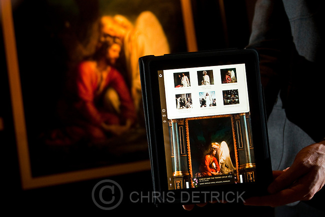 Chris Detrick  |  The Salt Lake Tribune .Jeff Sheets holds an interactive iPad in front of Danish painter Carl Bloch's 'Christ in the Garden of Gethsemane' at the Brigham Young University Museum of Art Tuesday November 9, 2010.