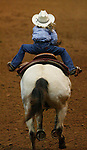 "3/15/07--Kylene Pickett is lifted out of her saddle as she sprints for the finish line on ""Go Avas Ace Glo"" in the Youth Pole Bending competition for ages 13 and under in the Reliant Arena at the Houston Livestock Show and Rodeo Thursday.  Photo by Steve Campbell, Chronicle Staff. ."