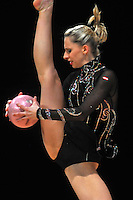 Caroline Weber of Austria performs cossack leap with ball during event finals at World Cup Montreal on January 30, 2011.  (Photo by Tom Theobald).