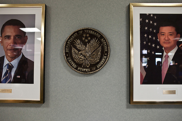 October 23, 2009. Durham, North Carolina.. Eric Shinseki, Secretary of Veterans Affairs for the Obama administration, visited Durham to meet with officials and veterans at the VA hospital, as well as to attend several events and meetings on the Duke University campus.. Photographs of Sec. Shenseki and President Barack Obama hang in the lobby of the VA hospital.