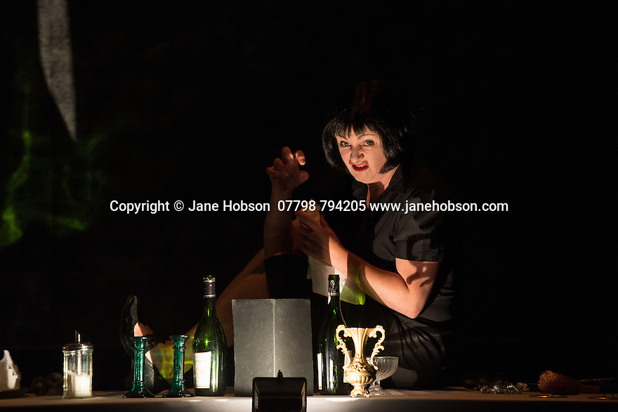 Edinburgh, UK. 12.08.2014.  SLEEPING BEAUTY, devised and performed by Colette Garrigan. This is not a fairy tale but a princess's tale. A princess from Liverpool. Born in a kingdom devastated by unemployment and famine, where the spindle has been replaced by a syringe. We are in a restaurant. The table is set. The waitress welcomes us. On the menu, a story. Artist and puppeteer Colette Garrigan tells her story using shadow theatre and object theatre. Stunningly poetic and original. 'You are all here! Charming! Are you sitting comfortably? Then I'll begin. It starts here, in this castle'. 'Closer to Ken Loach than to the sugary fairy tale' (Télérama). Photograph © Jane Hobson.