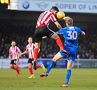 Lincoln City's Luke Waterfall vies for possession with Notts County's Jonathan Stead<br /> <br /> Photographer Chris Vaughan/CameraSport<br /> <br /> The EFL Sky Bet League Two - Lincoln City v Notts County - Saturday 13th January 2018 - Sincil Bank - Lincoln<br /> <br /> World Copyright &copy; 2018 CameraSport. All rights reserved. 43 Linden Ave. Countesthorpe. Leicester. England. LE8 5PG - Tel: +44 (0) 116 277 4147 - admin@camerasport.com - www.camerasport.com