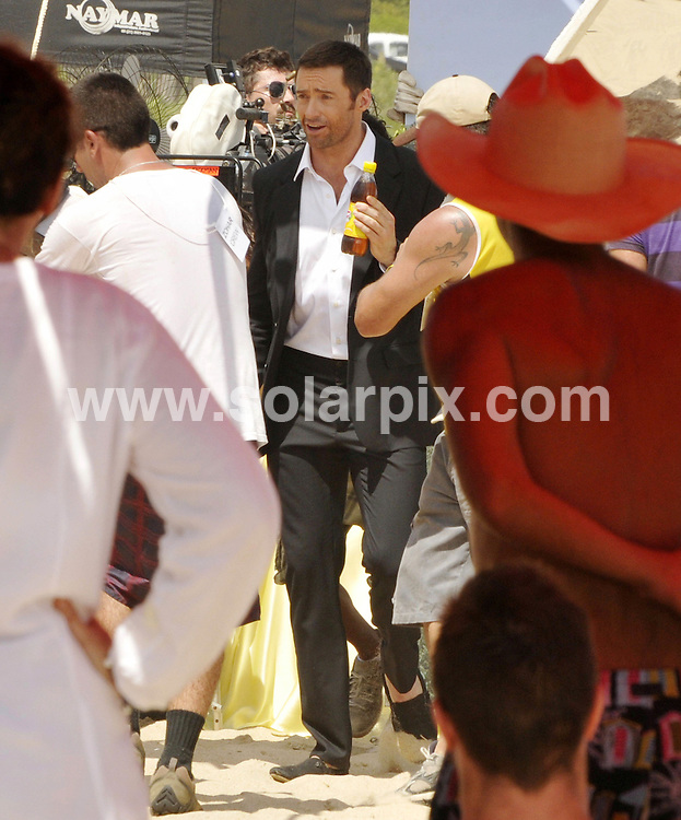 **ALL ROUND PICTURES FROM SOLARPIX.COM**.**SYNDICATION RIGHTS FOR UK AND SPAIN ONLY**.Australian actor Hugh Jackman filming a commercial on Grumari beach, Rio de Janeiro, for which he had to kiss a Brazilian actress. The 'Wolverine' star is accompanied by his family (wife Deborah-Lee, and children Ava and Oscar) who are enjoying the sunshine while Jackman was working. The actor and family are staying at luxury Copacabana Palace hotel. Rio de Janeiro, Brazil. 11 January 2010..This pic: Hugh Jackman..JOB REF: 10449 PRT Soalheiro       DATE: 11_01_2010.**MUST CREDIT SOLARPIX.COM OR DOUBLE FEE WILL BE CHARGED**.**MUST NOTIFY SOLARPIX OF ONLINE USAGE**.**CALL US ON: +34 952 811 768 or LOW RATE FROM UK 0844 617 7637**