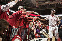 NWA Democrat-Gazette/ANTHONY REYES &bull; @NWATONYR<br /> Bobby Portis, Arkansas sophomore, celebrates with the student section against Tennessee Tuesday, Jan. 27, 2015 in Bud Walton Arena in Fayetteville. The Razorbacks won 69-64.