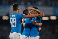 Calcio, Champions League Gruppo B: Napoli vs Benfica. Napoli, stadio San Paolo, 28 settembre 2016. <br /> Napoli's Dries Mertens, center, celebrates with his teammates Arkadiusz Milik, left, and Marek Hamsik, after scoring during the Champions League Group B soccer match between Napoli and Benfica at the Naples' San Paolo stadium, 28 September 2016. Napoli won 4-2.<br /> UPDATE IMAGES PRESS/Isabella Bonotto