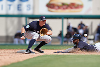 New York Yankees second baseman DJ LeMahieu (26) waits to receive a throw as Niko Goodrum (28) slides into second base during a Grapefruit League Spring Training game against the Detroit Tigers on February 27, 2019 at Publix Field at Joker Marchant Stadium in Lakeland, Florida.  Yankees defeated the Tigers 10-4 as the game was called after the sixth inning due to rain.  (Mike Janes/Four Seam Images)