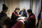 Workers from Tajikistan attend a civil court hearing after they were arrested for working without a permit in Moscow. Russia is cracking down on foreign nationals working in its markets and construction sites.