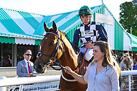Winner of The Comec Voice & Data Handicap Ship of The fen ridden by Jason Watson and trained by Ian Williams is led into the Winners enclosure during Evening Racing at Salisbury Racecourse on 25th May 2019