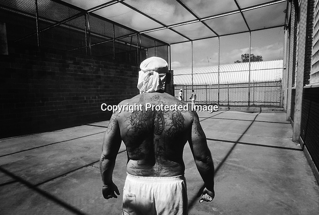 Texas Death Row inmate Richard Foster stands in the exercise area on April 16, 1997 at Ellis Unit in Huntsville, Texas USA. He's a Vietnam veteran and been on Death Row for 11 years. Texas has about 450 prisoners on death row. The state leads all records in executing people around the US. The prisoners are executed by lethal injection. (Photo by: Per-Anders Pettersson).....
