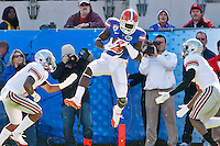 January 02, 2012:    Florida Gators wide receiver Deonte Thompson (6)  catches a pass for a touchdown during first quarter action at the 2012 Taxslayer.com Gator Bowl between the Florida Gators and the Ohio State Buckeyes at EverBank Field in Jacksonville, Florida.