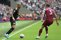 Kyle Walker of Manchester City and Aaron Cresswell during West Ham United vs Manchester City, Premier League Football at The London Stadium on 10th August 2019