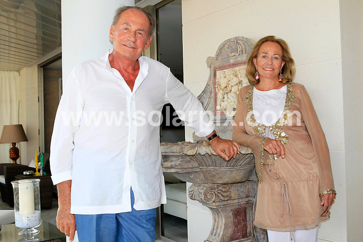 **ALL ROUND EXCLUSIVE PICTURES FROM SOLARPIX.COM**                                             **WORLDWIDE SYNDICATION RIGHTS EXCEPT SPAIN - NO SYNDICATION IN SPAIN**                                                                                  Caption: Pal Sarkozy, father of President of France Nicolas Sarkozy, talking candidly about his son's upbringing and about the pregnancy of Nicolas Sarkozy's wife Carla Bruni. Pal speaks with his wife Agnes and shows us around his home on the spanish island of Ibiza. Interview text available. Spain, 24 August 2011                                                                            This pic:  Pal and Agnes Sarkozy                                                                              JOB REF: 13877 JMB               DATE: 24_08_2011                                                           **MUST CREDIT SOLARPIX.COM OR DOUBLE FEE WILL BE CHARGED**                                                                      **MUST AGREE FEE BEFORE ONLINE USAGE**                               **CALL US ON: +34 952 811 768 or LOW RATE FROM UK 0844 617 7637**