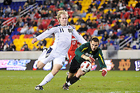 Louisville Cardinals goalkeeper Andre Boudreaux (30) denies Steven Perry (11) of the Notre Dame Fighting Irish during the semi-finals of the Big East Men's Soccer Championship at Red Bull Arena in Harrison, NJ, on November 12, 2010.