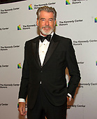Pierce Brosnan arrives for the formal Artist's Dinner honoring the recipients of the 42nd Annual Kennedy Center Honors at the United States Department of State in Washington, D.C. on Saturday, December 7, 2019. The 2019 honorees are: Earth, Wind & Fire, Sally Field, Linda Ronstadt, Sesame Street, and Michael Tilson Thomas.<br /> Credit: Ron Sachs / Pool via CNP