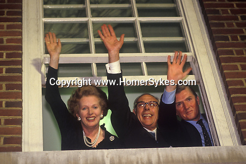 Mrs Margaret Thatcher, Denis Thatcher, Cecil Parkinson, winning the 1983 General Election waving to assembled crowd from Conservative Party Head  offices London.  1980s. UK