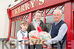Kevin O'Regan, with his son Luke, pictured with Jim O'Gorman Sports Editor with Kerry's Eye, receives the prize for winning the Kerry's Eye Fantasy Football Online Competition on Monday.