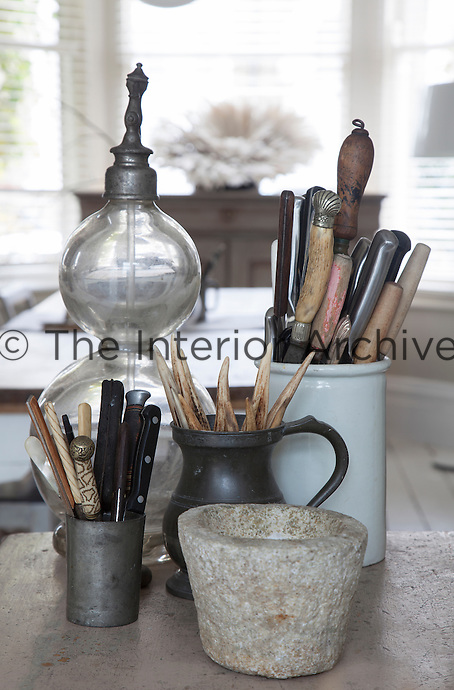 The ethos in Ryan's home is that everything can be multi-functional, such as this collection of pots used to store kitchen utensils