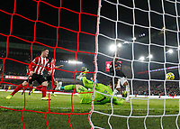 24th November 2019; Bramall Lane, Sheffield, Yorkshire, England; English Premier League Football, Sheffield United versus Manchester United; John Fleck  of Sheffield United scores past David De Gea of Manchester United in the 19th minute to make it 1-0 - Strictly Editorial Use Only. No use with unauthorized audio, video, data, fixture lists, club/league logos or 'live' services. Online in-match use limited to 120 images, no video emulation. No use in betting, games or single club/league/player publications