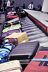 Row of suitcases, luggage on airport baggage claim conveyor carousel, Toronto Pearson International Airport, Ontario, Canada