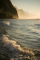 The tide rolls in at sunset at Ke'e Beach on the North Shore of Kaua'i.