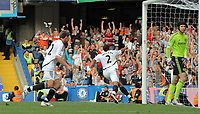 Pictured: Ashley Williams of Swansea (C) celebrating his goal to the delight of Swansea supporters in the background. Saturday 17 September 2011<br />