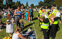 "2016 09 18<br /> Pictured: Performers as members of the ""Ministry of the Predictable"" measuring children to see if they are a legal size. The Great Pyjama Picnic, Bute Park, Cardiff.Sunday 18 September 2016<br /> Re: Roald Dahl's City of the Unexpected has transformed Cardiff City Centre into a landmark celebration of Wales' foremost storyteller, Roald Dahl, in the year which celebrates his centenary."