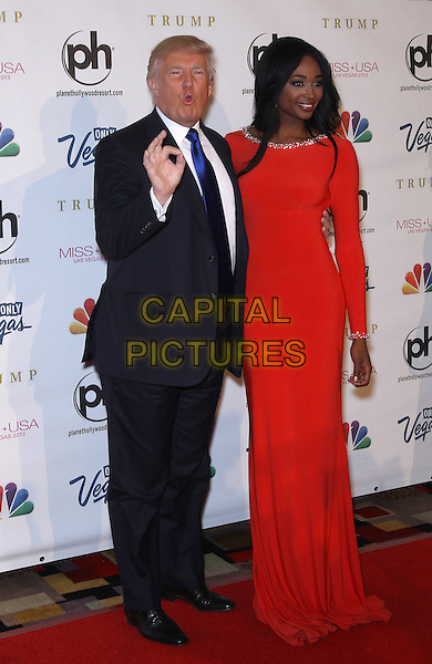 Donald Trump, Nana Meriwether<br /> 2013 Miss USA Pageant Red Carpet at Planet Hollywood Resort and Casino, Las Vegas, NV., USA.<br /> June 16h, 2013<br /> full length hand thumb ok sign mouth open red dress blue suit tie white shirt<br /> CAP/ADM/MJT<br /> &copy; MJT/AdMedia/Capital Pictures