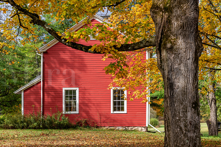 Charming red house with autumn foliage, Bennington, Vermont, USA.