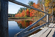 Chocorua Lake in Tamworth, New Hampshire USA during the autumn months . This lake offers a excellent view of Mount Chocorua