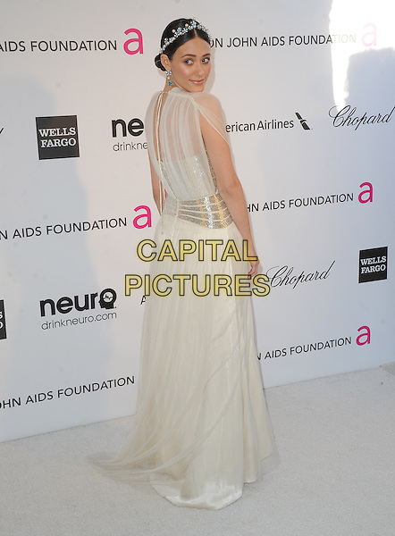 Emmy Rossum.The 21st Annual Elton John AIDS Foundation Academy Awards Viewing Party held at The City of West Hollywood Park in West Hollywood, California, USA..February 24th, 2013.oscars full length dress white sheer blue pearls silver belt hairband  back behind rear looking over shoulder                .CAP/DVS.©DVS/Capital Pictures.