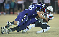 NWA Democrat-Gazette/ANDY SHUPE<br /> Elkins linebacker J.J. Miller (88) and defensive lineman Logan Shoffit take down Fordyce running back Quartey Shelton Friday, Nov. 10, 2017, during the first half of play at John Bunch Jr. Memorial Field in Elkins. Visit nwadg.com/photos to see more photographs from the game.
