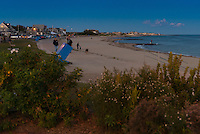 People walking on Falmouth Heights beach at dusk, Cape Cod