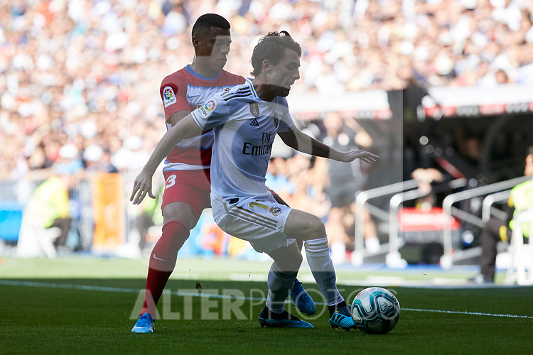 Alvaro Odriozola of Real Madrid and Alejandro Martinez of Granada CF during La Liga match between Real Madrid and Granada CF at Santiago Bernabeu Stadium in Madrid, Spain. October 05, 2019. (ALTERPHOTOS/A. Perez Meca)
